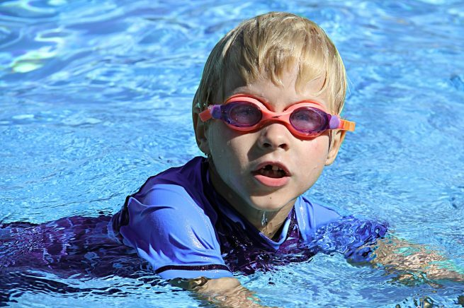 Swimming toddler boy